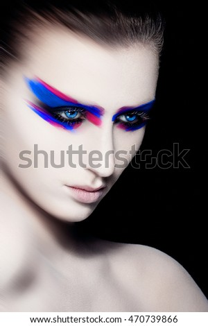 Beauty creative art makeup on black background.Fashion portrait.Head shot. Creative portrsit.