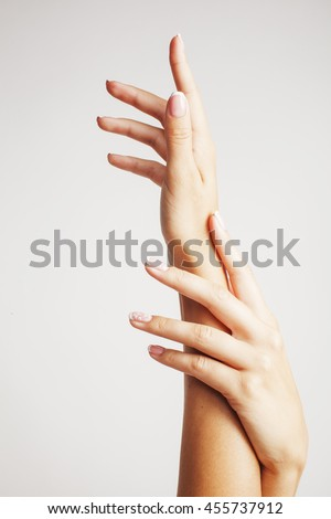 beauty delicate hands with french manicure close up isolated on white
