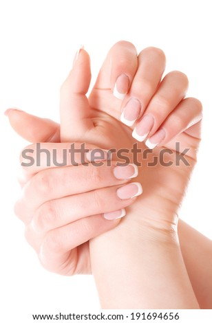 Beauty elegant women hands with france manicure isolated on white.