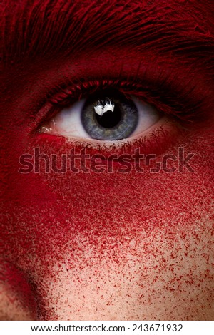 Beauty eye with red dry paint makeup - stock photo