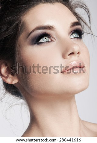 Beauty face makeup. Make up. Eyelashes extensions. Perfect Make-up closeup. Foundation. Cosmetic Eyeshadows, eyebrows. Beauty Girl with Perfect Skin. Eyelashes. Makeover - stock photo