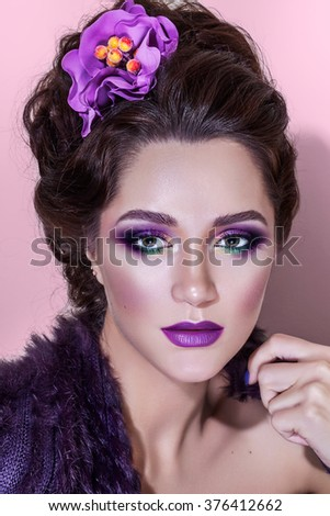Beauty face makeup. Make up. Eyelashes extensions. Perfect Make-up closeup. Foundation. Cosmetic Eyes shadows, eyebrows. Beauty Girl with Perfect Skin. Eyelashes. Spring style with flower - stock photo