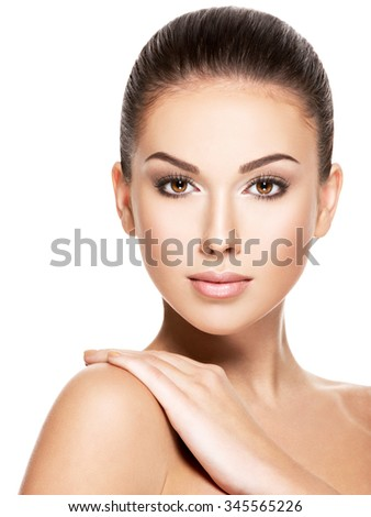 Beauty face of the young beautiful woman - isolated on white - stock photo