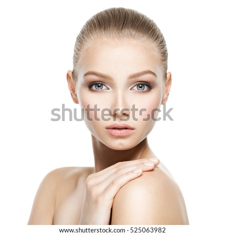 Beauty face of the young beautiful woman - isolated on white