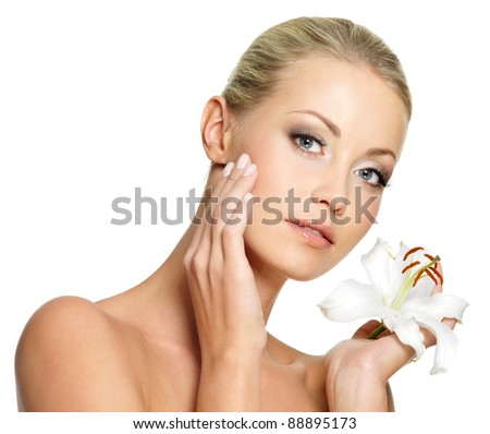 Beauty face of the young beautiful woman with flower on white background - stock photo