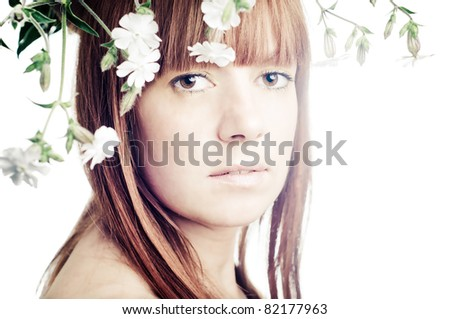 Beauty face of the young beautiful woman with flowers - stock photo