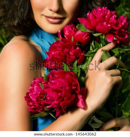 Beauty face of the young woman with red flowers - stock photo