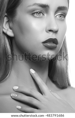 Beauty face of young girl with maroon lipstick and hand on neck isolated on white background. Studio portrait. Black and white