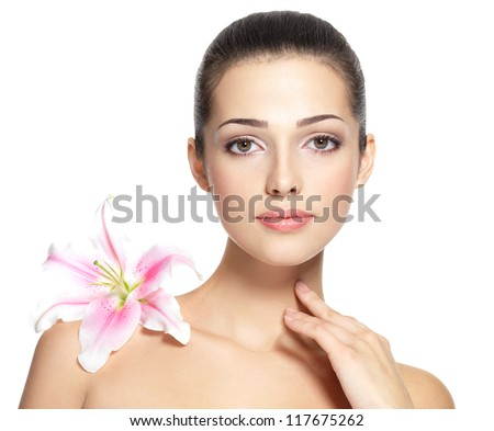 Beauty face of young woman with flower. Beauty treatment concept. Portrait over white background - stock photo