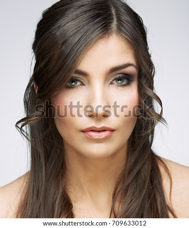 Beauty face portrait of young woman. Isolated. long hair.