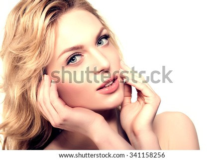 Beauty face woman. Female healthy model in spa salon. Cream treatment products. Facial skin therapy - stock photo