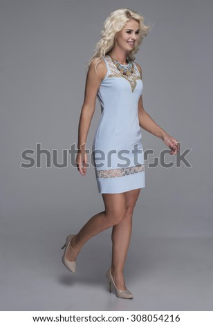 beauty, fashion and young woman in blue dress walking - stock photo