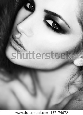beauty fashion close-up Portrait of beautiful young woman with bright make-up. the black and white photo - stock photo