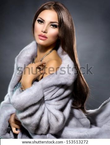 Beauty Fashion Model Girl in Blue Mink Fur Coat. Beautiful Luxury Winter Woman. Grey Mink Jacket Wear - stock photo