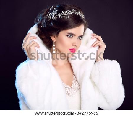 Beauty Fashion Model Girl in white Mink Fur Coat. Beautiful Luxury Winter Woman isolated on dark background. - stock photo