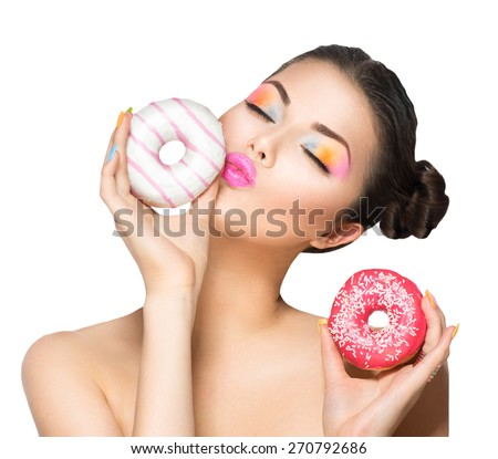 Beauty fashion model girl taking sweets and colorful donuts. Funny joyful Vogue styled woman choosing sweets isolated on white background. Diet, dieting concept. Junk food, Slimming, weight loss - stock photo