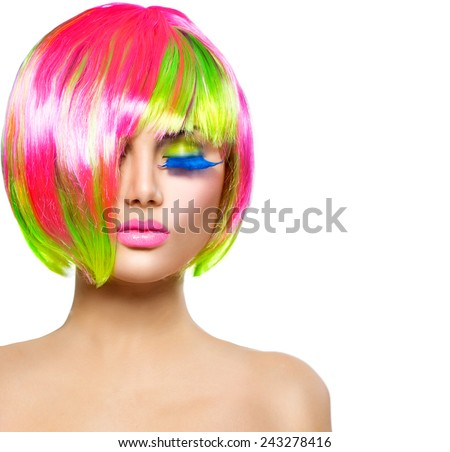 Beauty Fashion Model Girl with Colorful Dyed Hair. Haircut with fringe. Colourful short Hair. Portrait of a Beautiful Girl with Dyed Hair, professional hair Coloring. Colouring hair  - stock photo
