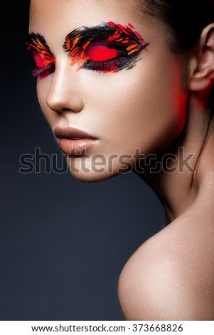Beauty fashion model girl with dark bright orange make-up. Close up portret. - stock photo