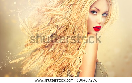 Beauty Fashion model girl with gold long wheat ears hair. Beautiful Fashion art portrait of young sexy blonde woman with wheat hairstyle. Organic cosmetic products for healthy hair concept - stock photo