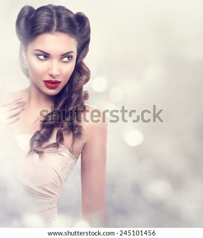 Beauty fashion model retro girl over blinking background. Vintage style Woman Portrait. Luxury Lady with Holiday Magic background. Miracle Light. Copy Space  - stock photo