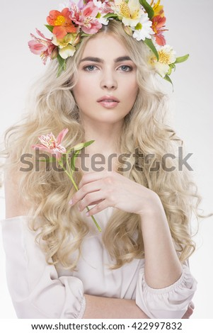Beauty Fashion Portrait. Beautiful Woman with Curly Hair, Makeup and Flowers Wreath - stock photo
