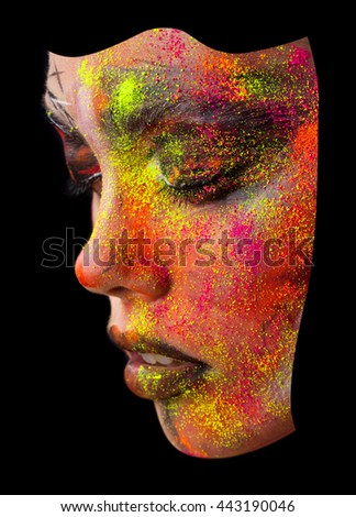 Beauty fashion portrait of a girl close-up. bright creative make-up. Face model sprinkled colored powder - stock photo
