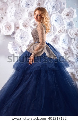 Beauty fashion portrait of beautiful blonde woman in fairy luxury blue dress