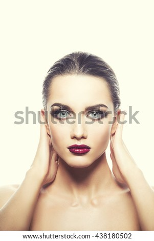 Beauty fashion portrait of caucasian brunette woman wet wet red lipstick and arms touching face. Isolated on white background. Toned - stock photo
