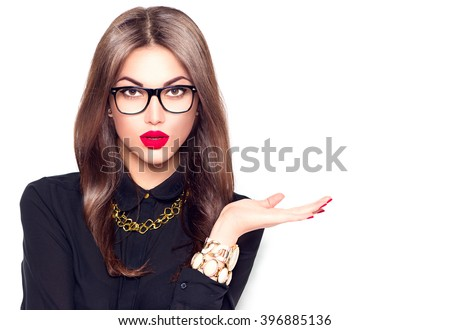 Beauty fashion sexy girl wearing glasses showing empty copy space on the open hand palm for text, white background. Happy girl presenting point. Proposing product. Advertisement gesture - stock photo