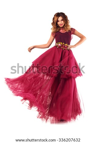 Beauty fashion woman model in fluttering red marsala dress. Isolated on white background. - stock photo