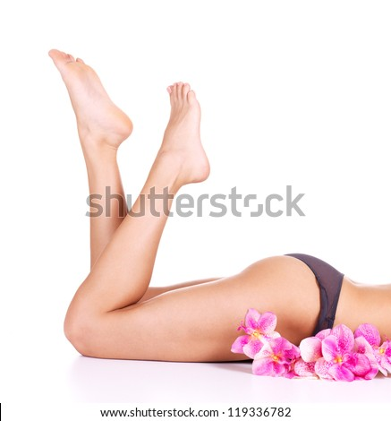 Beauty female slim legs after spa -  isolated on white