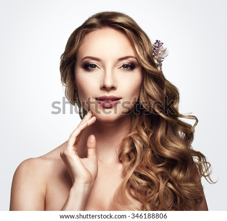 Brunette girl long shiny wavy hair stock photo 457580683 beautiful woman with long wavy hair touching her face flower in the urmus Images
