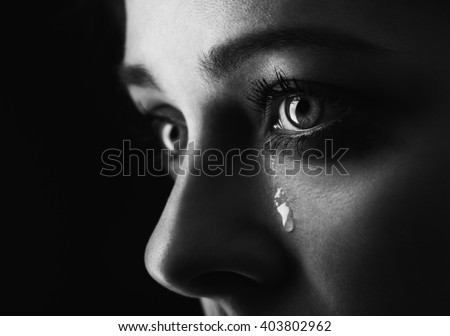 beauty girl cry on black background (height contrast film monochrom edit) - stock photo