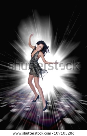 Beauty girl dancing on music on the dance floor - stock photo