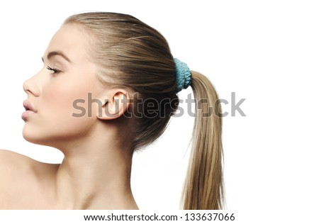 Beauty girl face with ponytail, blue ribbon,isolated on white - stock photo