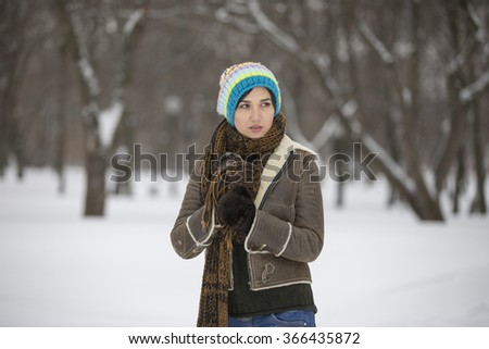 Beauty Girl in frosty winter Park. Outdoors.