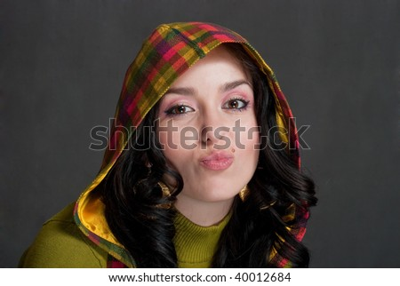 beauty girl in  hood of tattersall on the gray background