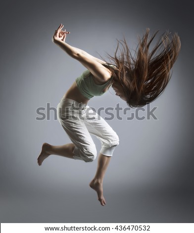 beauty girl jump in dance on grey background - stock photo