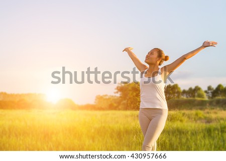 Beauty Girl Outdoors enjoying nature. wake up in the morning with sunrise.dream soft style.