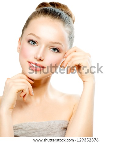 Beauty Girl Portrait. Front View of Beautiful Young Woman isolated on a White Background. Touching Her Face. Fresh Clean Skin. - stock photo