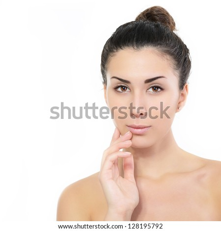 beauty girl portrait, young beautiful woman portrait with clean skin holding hand near face, over white studio shot - stock photo