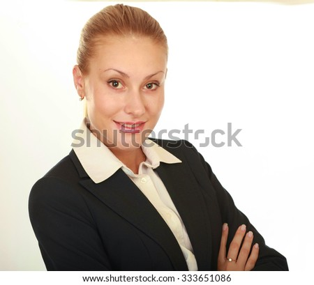 Beauty girl portrait. Young natural woman with clean face sitting at white table leaning on her elbows, over white background - stock photo