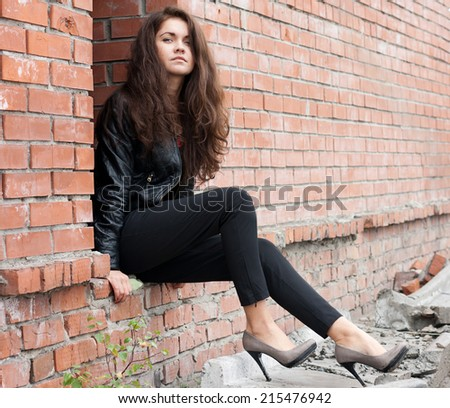 beauty girl posing fashion near red brick wall on the street - stock photo