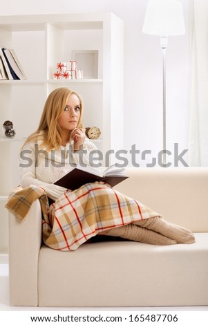 beauty girl reading book in the room