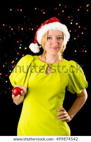 Beauty girl wearing green dress and xmas red hat with red christmas