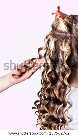 Beauty girl with blonde curly hair. Healthy and long Blond Wavy hair. - stock photo