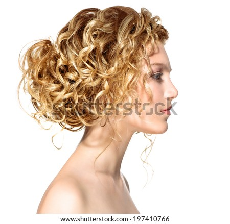 Beauty girl with blonde curly hair. Healthy and long Blond Wavy hair. Beautiful young woman profile portrait isolated on a white background. Hairstyle