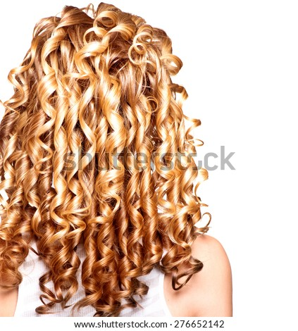 Beauty girl with blonde curly hair. Healthy and long Blond Wavy hair. Long permed hair. Beautiful young woman. Backside. Rear view. Hair perm, Hair extensions - stock photo