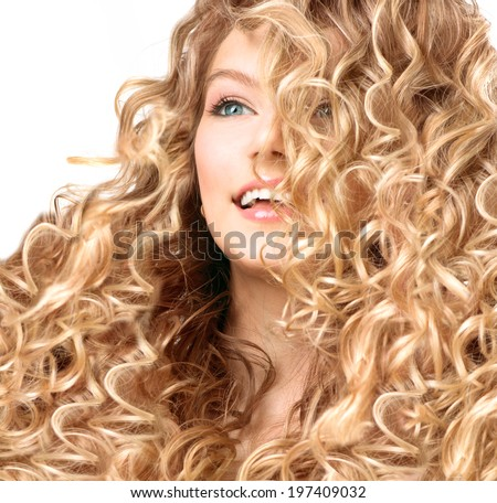 Beauty girl with blonde curly hair. Healthy and long permed Blond Wavy hair. Beautiful smiling young woman portrait. Beautiful face, natural make up - stock photo