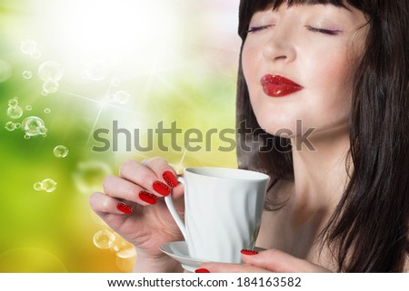 Beauty Girl With Cup of Coffee or Tea. Happy Girl with hot beverage - stock photo